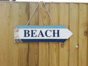 beach sign in garden beeches holiday lets