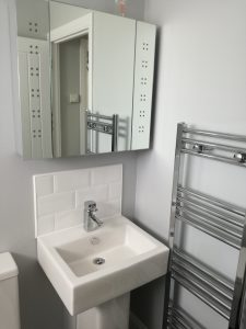 family bathroom chrome fittings and white suite